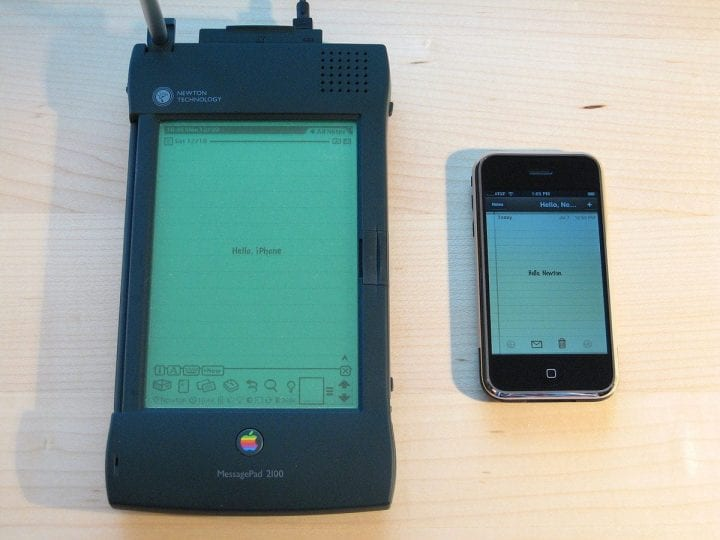 a giant newton iphone next to an actual iphone