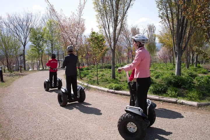 segways looking gross and disgusting with people wearing helmets
