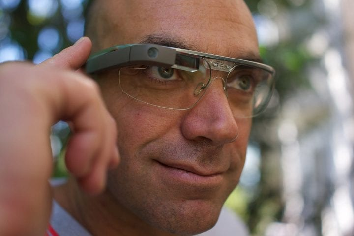 a man wearing google glasses