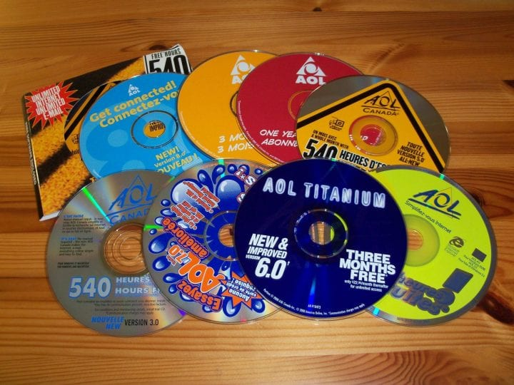 a bunch of cds in a disheveled pile