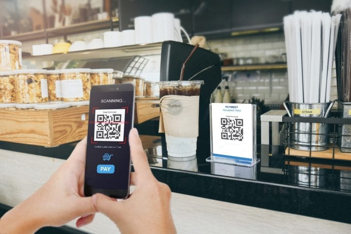 Qr code payment, E wallet , cashless technology concept. Man scaning  tag in Coffee shop accepted generate digital pay without money.Qr code payment, E wallet , cashless technology concept. Man scanning  tag in Coffee shop accepted generate digital pay without money.