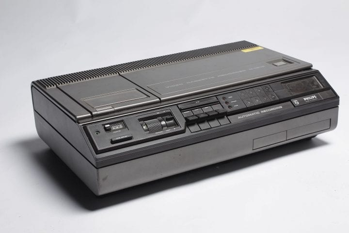 a vcr that's black against a backdrop of white