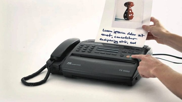 a fax machine that is hooked up to a phone