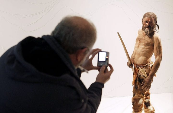 A man takes pictures of a statue representing an iceman named Oetzi, discovered on 1991 in the Italian Schnal Valley glacier, is displayed at the Archaeological Museum of Bolzano on February 28, 2011 during an official presentation of the reconstrution. Based on three-dimensional images of the mummy's skeleton as well as the latest forensic technology, a new model of the living Oetzi has been created by Dutch experts Alfons and Adrie Kennis. AFP PHOTO / Andrea Solero (Photo credit should read Andrea Solero/AFP/Getty Images)