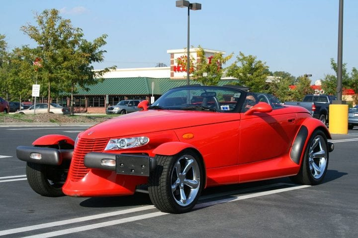 a hot red car in a parking lot