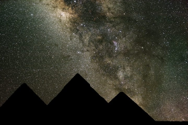 Long exposure for the night sky combined with a shorter exposure for the pyramids.
