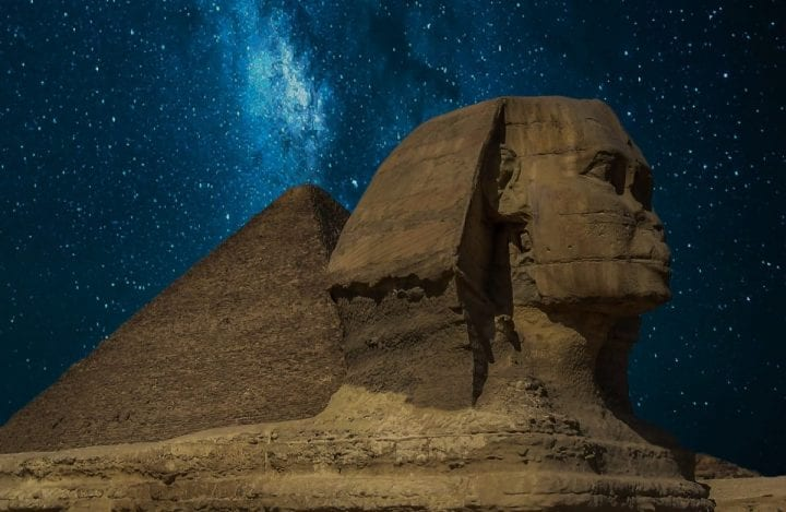 milky way over pyramid and sphinx