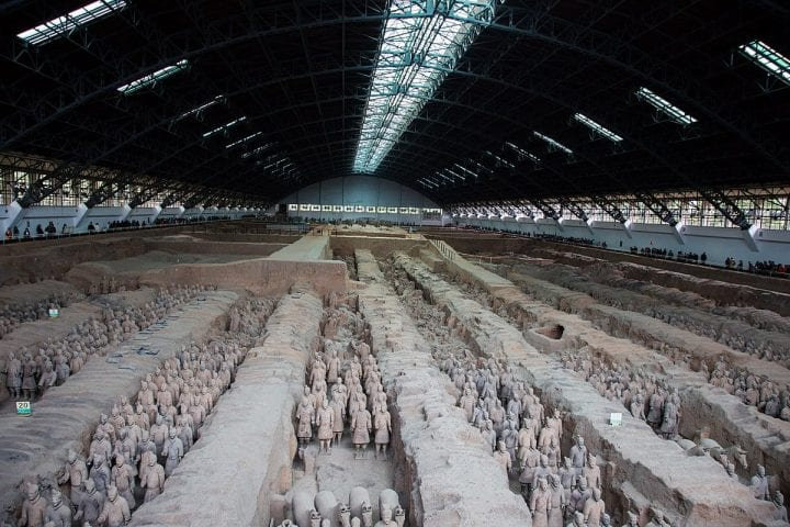 an army of clay soldiers in a warehouse somewhere