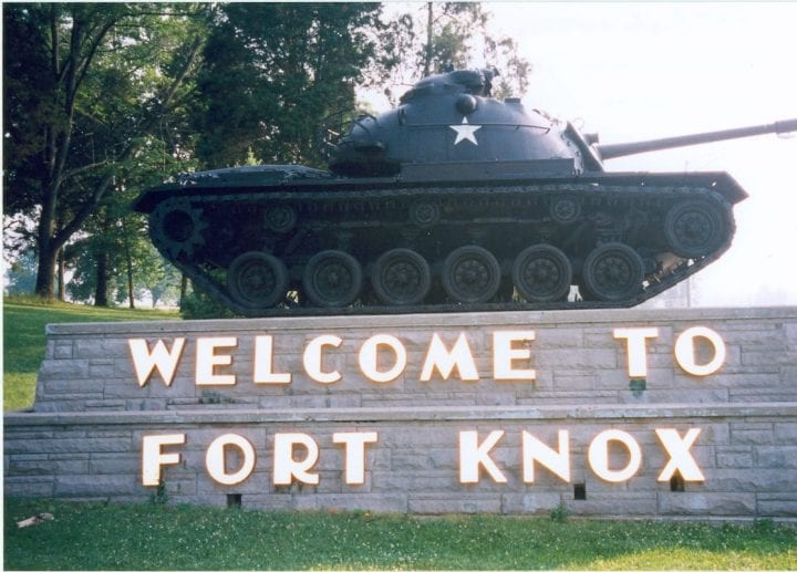 a tank on the welcome sign to fort knox