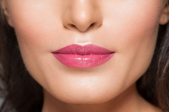 woman's lips with smooth skin
