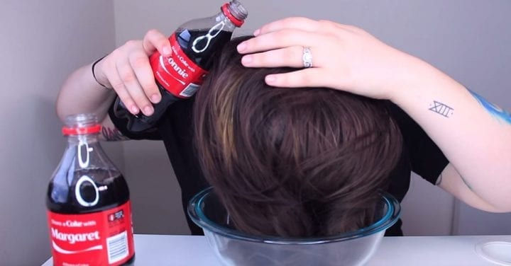 woman pours coke into her hair