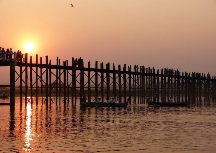 sunset over a bridge in myanmar