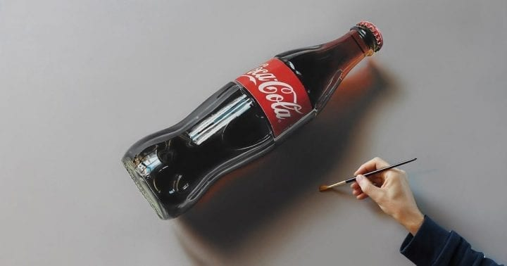 a coke bottle on a backround that somebody is painting