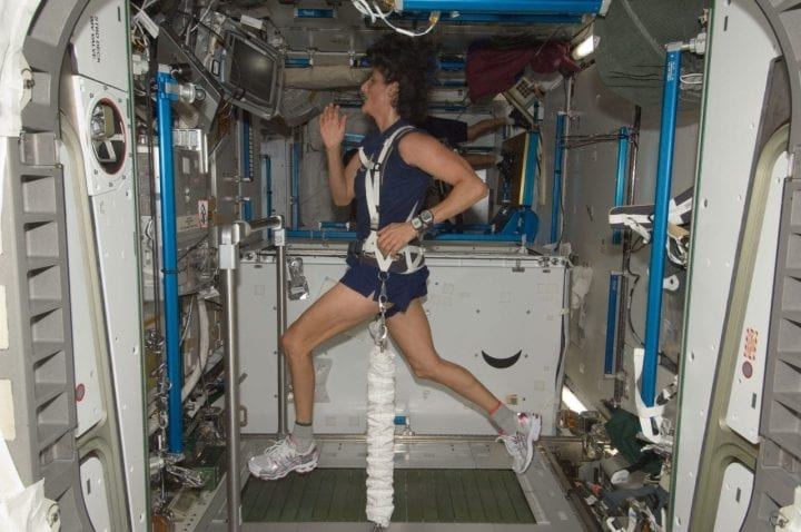 Astronaut working out treadmill sweat space