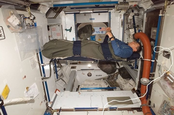 Astronaut sleeping space station