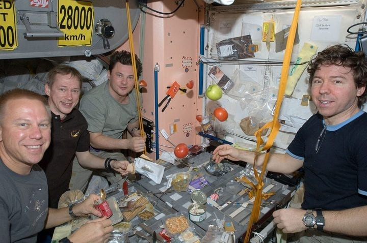 Astronauts eating meal space zero gravity