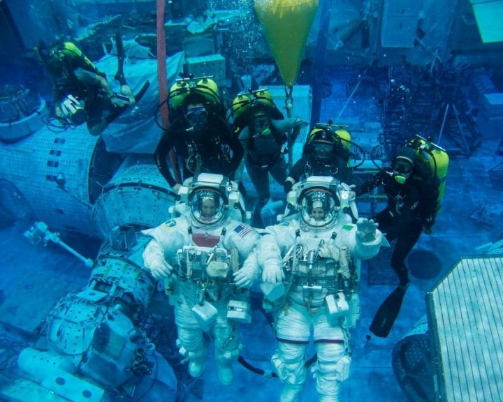 Astronauts underwater training space suits