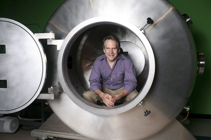 man sits in weird tube