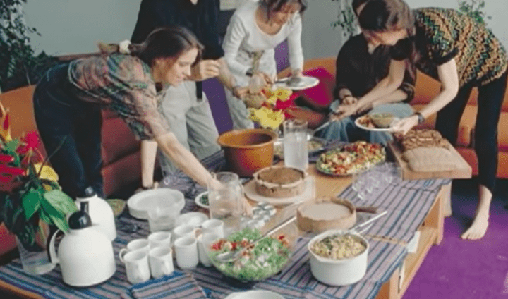 people standing over a vegetarian banquet