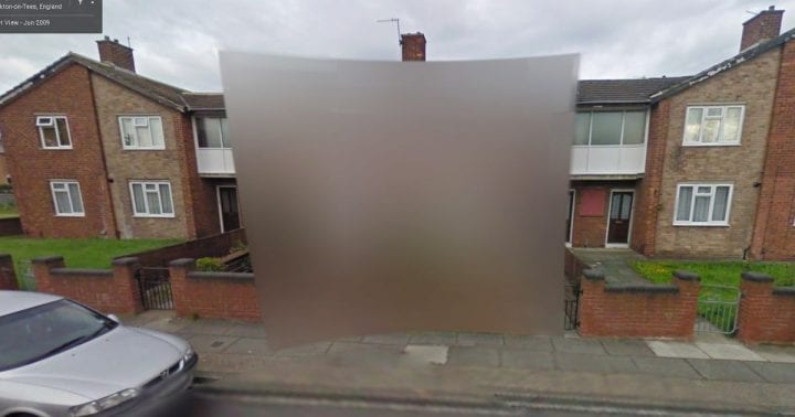 blurred photo of a house from google maps