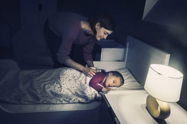 Mother sleeping child light on habit