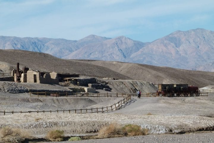 people in death valley in a derelict village