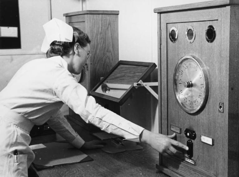 Nurse setting up Radium Treatment in a London Hospital