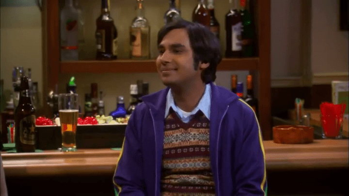 raj in a bar drinking a pint