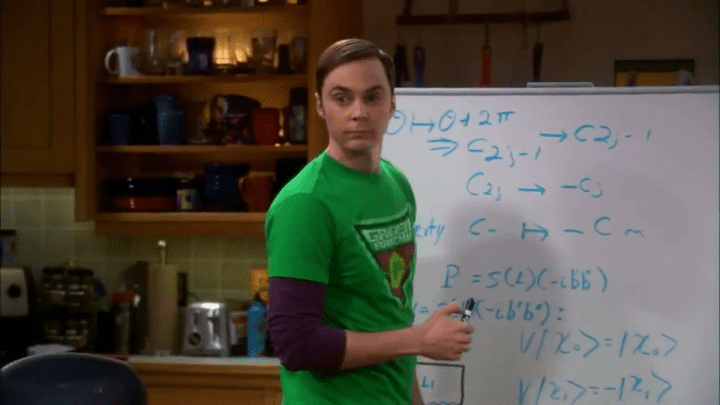 sheldon writes math on a white board