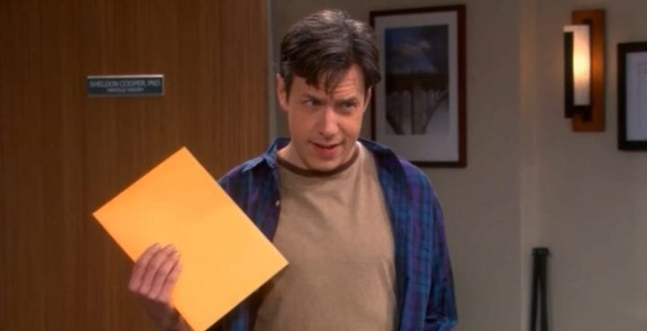 man holding a yellow folder