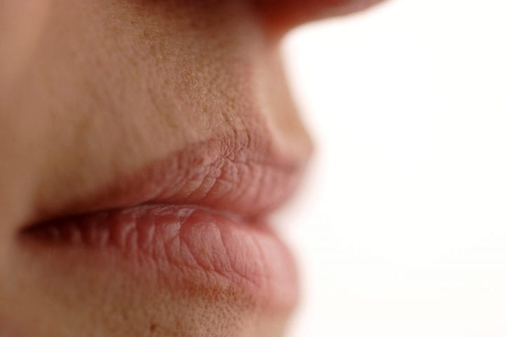 profile of natural lips of a young woman (shallow dof)