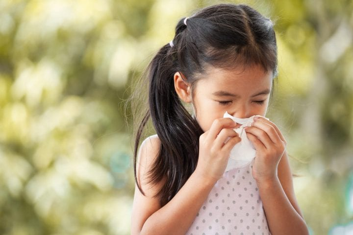 Girl blowing nose tissue sick snot myth
