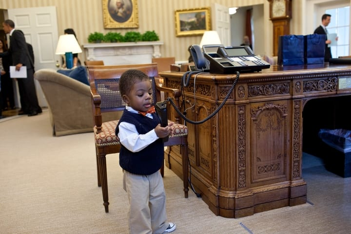 child holding oval office phone