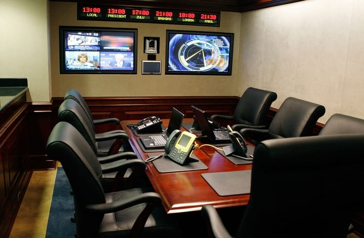 Phones, laptops and TV screens in the Situation Room