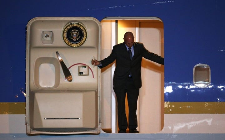 Man opening door of Air Force One