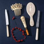 A collection of objects made of xylonite and ivoride manufactured by Daniel Spill. As well as two knives with ivoride handles, there is a hair comb in ivoride and xylonite. part of a xylonite necklace and a cravat pin with a red xylonite head. The small hand mirror is made of ivoride, as is the death's head handle, which was from Spill's own walking stick and was donated by his granddaughter. Ivoride and xylonite are made of celulose nitrate, a form of celluloid developed by Alexander Parkes (1813-1890) in 1855. Daniel Spil was Parkes' works manager and later independent manufacturer of his invention