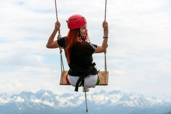 A girl on a swing at the Rosa Khutor alpine ski resort in Krasnaya Polyana.