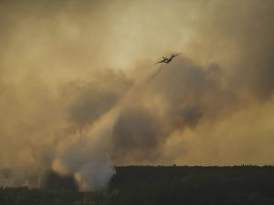 A Ukrainian airplane drops water onto a forest fire in the Chernobyl Exclusion Zone.