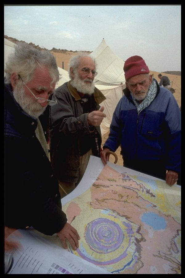 Theodore Monod and his team consult a map of the Richat area to work out their route