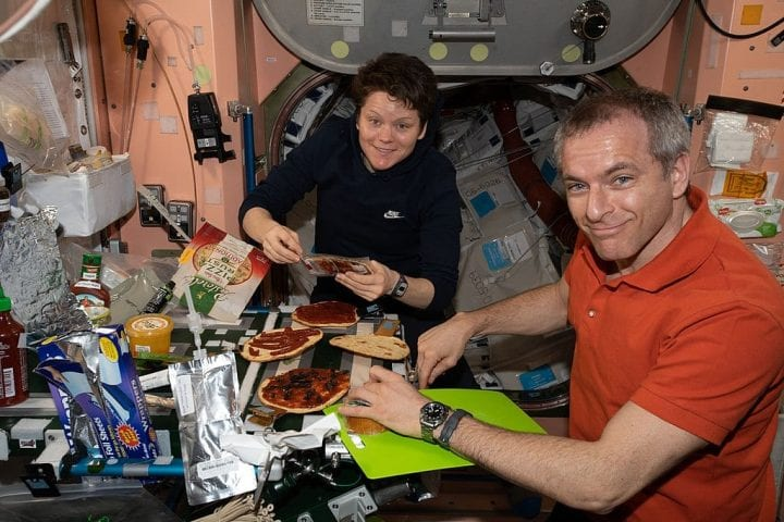Astronauts eating pizza in space