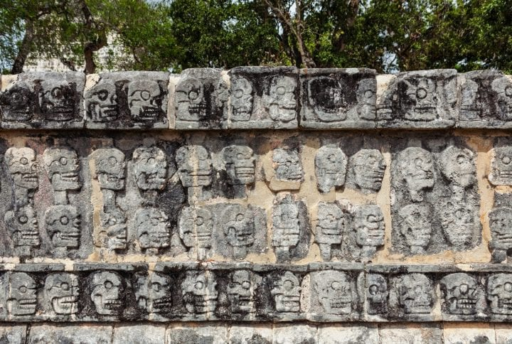 Tzompantli or Platform of the skulls, Chichen Itza, Yucatan Peninsula, Quintana Roo, Mexico The skulls of enemies killed in battle or sacraficed were placed here. (