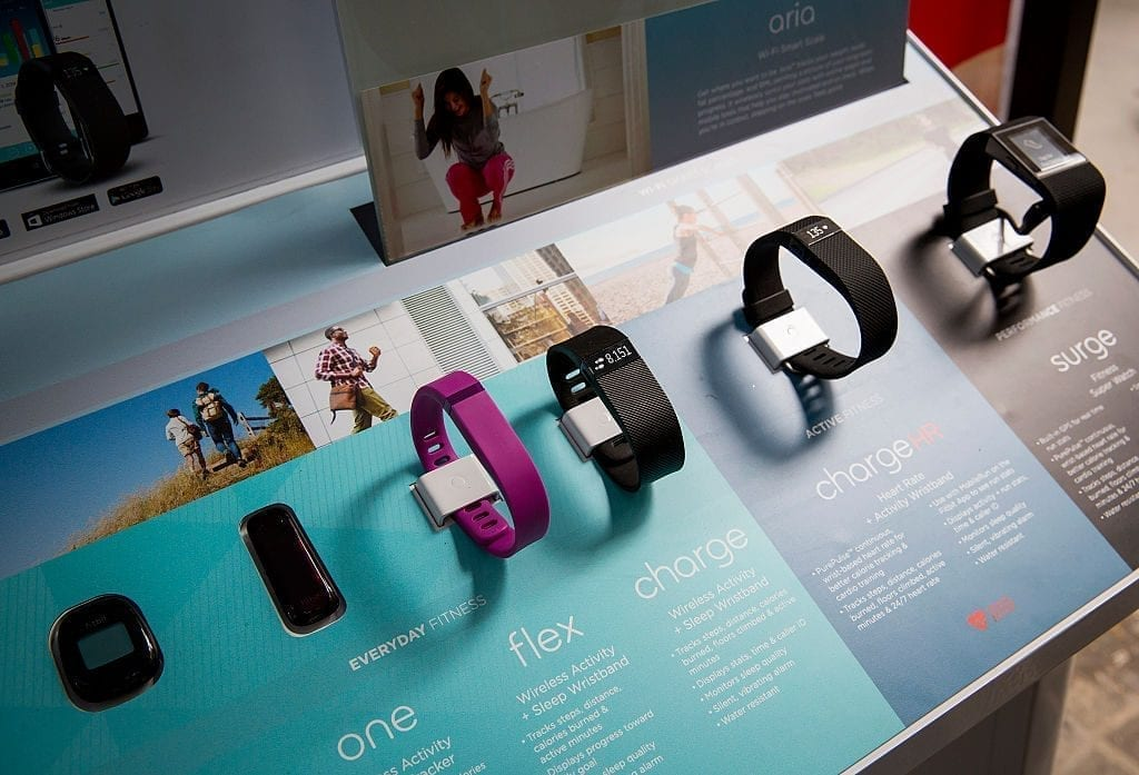 The line of Fitbit products are displayed during a lunchtime workout event outside the New York Stock Exchange during the IPO debut of the company