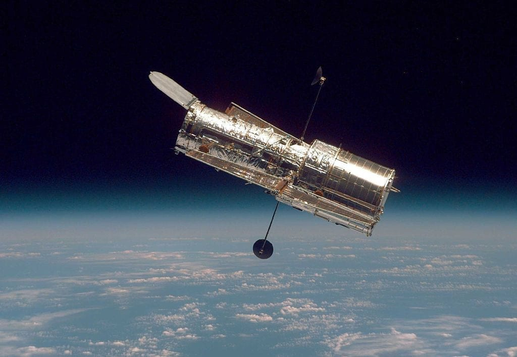 In this handout from the National Aeronautical Space Administration (NASA), the Hubble Space Telescope drifts through space in a picture taken from the Space Shuttle Discovery