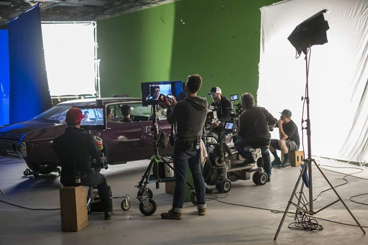 A car scene with plenty of crew