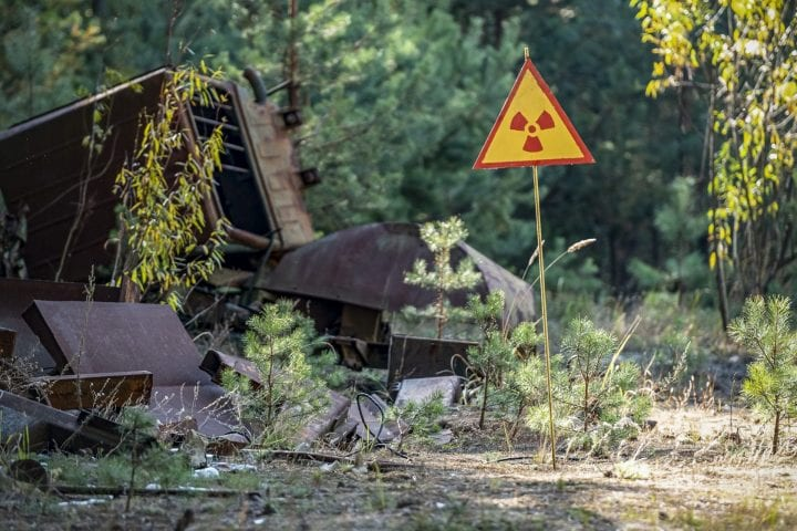 sign of radiation hazard on the background of radioactive garbage