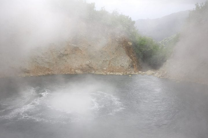The Boiling Lake on Dominica which is heated by a dormant volcano. Note: there is a lot of rising steam making visibility difficult.See related: