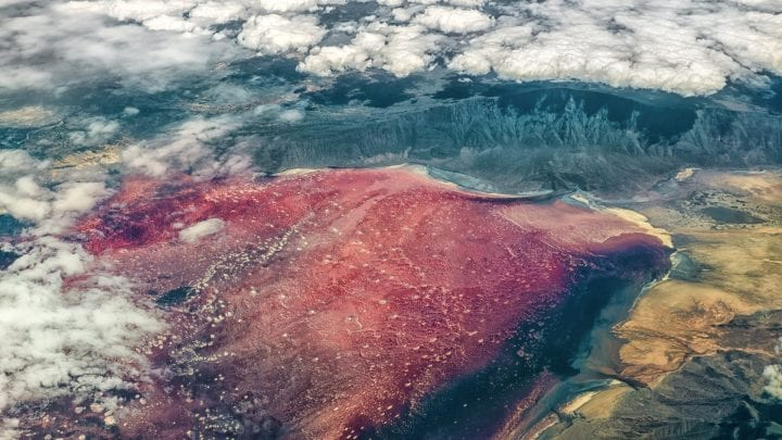 Aerial view of Lake Natron, found near Mount Kilimanjaro in Tanzania, with bright red color attributed to salt loving halophile organisms
