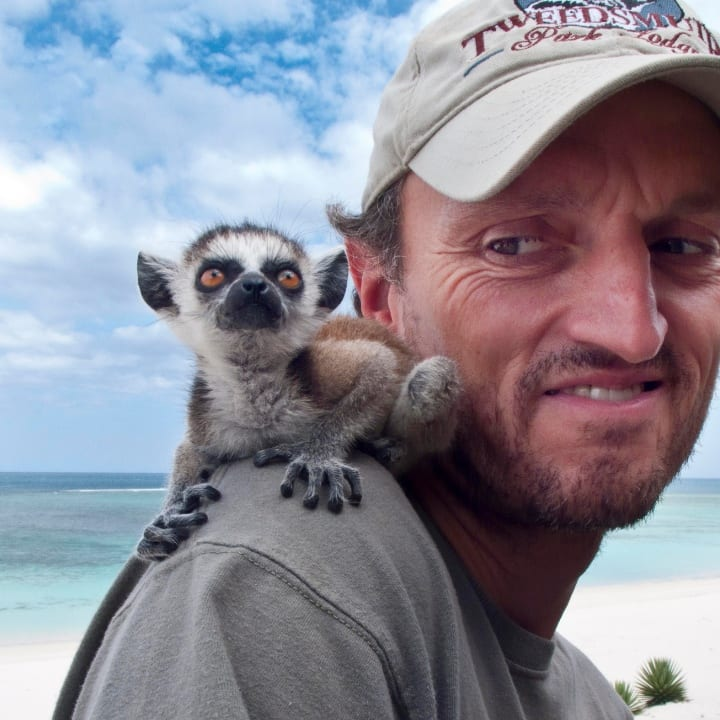 Nick Garbutt with an orpahned baby Ring-tailed Lemur, near Tsimanampetsotsa National Park in November 2009 in Madagascar. A British photographer has completed an epic 20 year foray into the world's most unique eco-system - described as the 'Noah's Arc of diversity'. Nick Garbutt, 46, from Cumbria, has made an incredible 25 trips deep into the forests of the diverse island - visiting every year since 1991 - with 2011 marking an unrivalled two decades of exploration. Collectively spending over three years - and taking over 250 international and domestic flights to and around the island - pioneer Nick has built an extraordinary collection of wildlife photography revealing some of the islands most stunning species up close.
