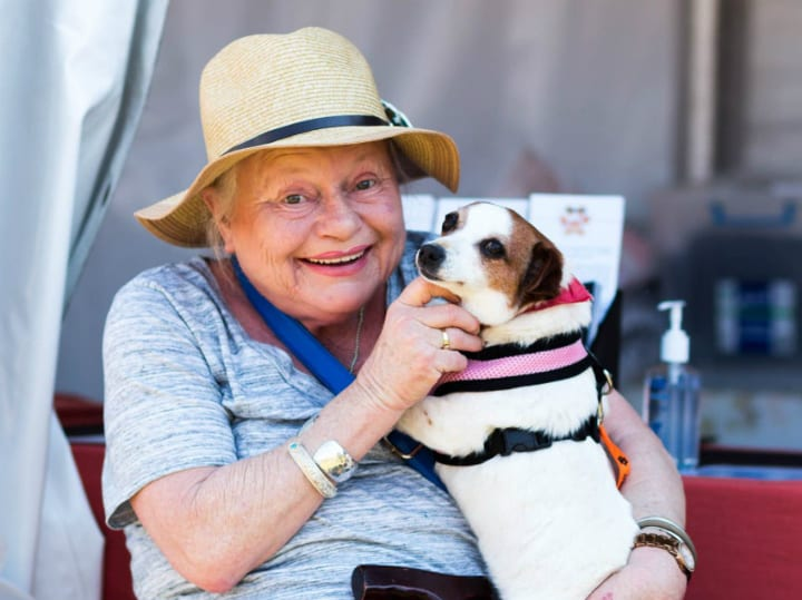 older woman adopted cute dog