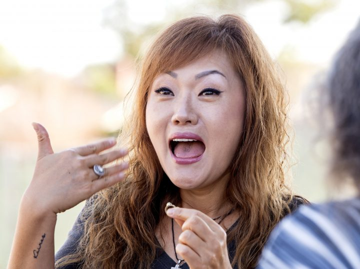 FULLERTON, CA - SEPTEMBER 02: Charlotte Kim reacts after Christine Montgomery returns her lost 1982 Granada Hills High class ring in Fullerton on Friday, September 2, 2016. Christine Montgomery who is a treasure hunter found the ring while using her metal detector on the property of the former FullertonÕs Hanmaum Presbyterian Church. (Photo by Leonard Ortiz/Digital First Media/Orange County Register via Getty Images)